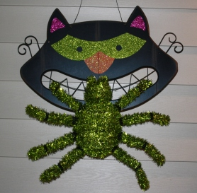 Who will win? Yucky green spider or evil-eyed black cat?
